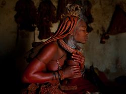 Himba Woman Perfuming Herself with Smoldering Herbs {Fragrant Images}