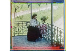 Pensive Young Woman with a Bouquet of Flowers in Twilight of the Romanovs {Perfume Images & Ads}