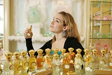 camille Goutal spraying perfume.jpg